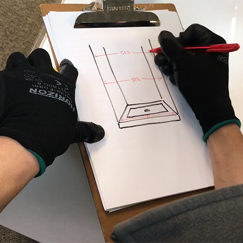 fleurco installer marking down the middle measurement on their drawing